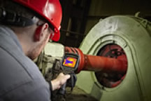 man using infrared camera in manufacturing